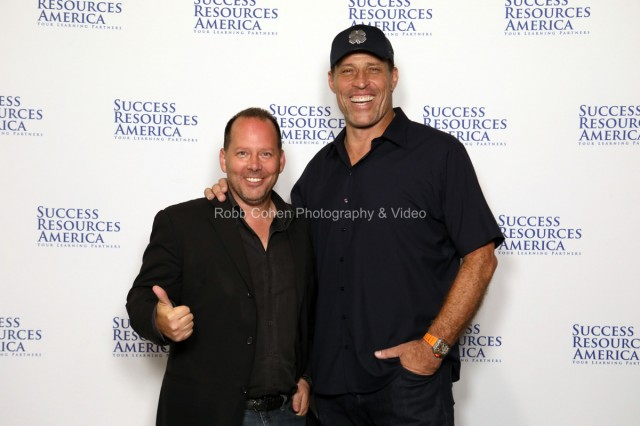 Tony Robbins poses with attendees