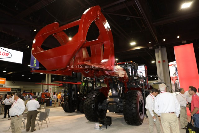 Large machinery on the exhibit hall floor.
