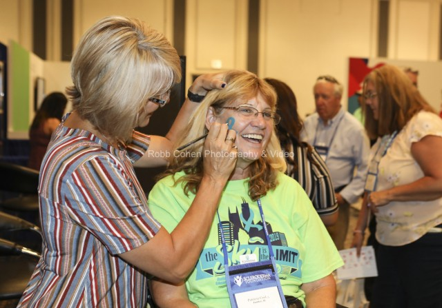 Attendee getting face painted.