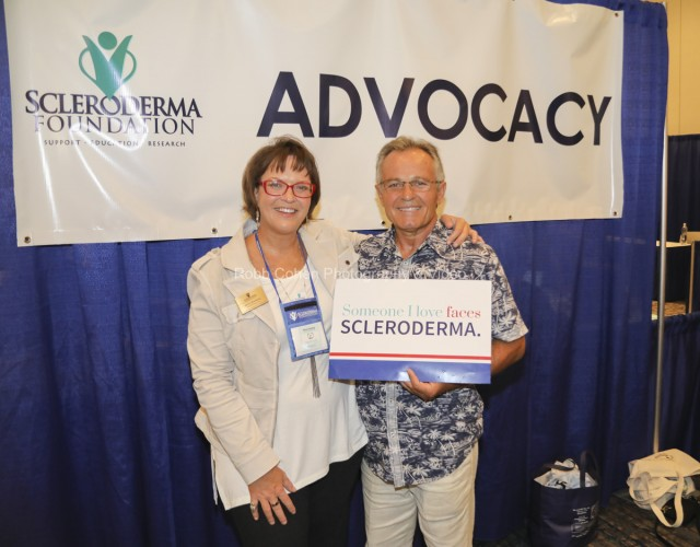 Attendee getting award at Scleroderma conference.