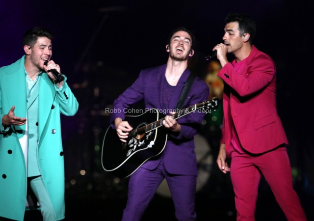 The Jonas Brothers perform on stage.